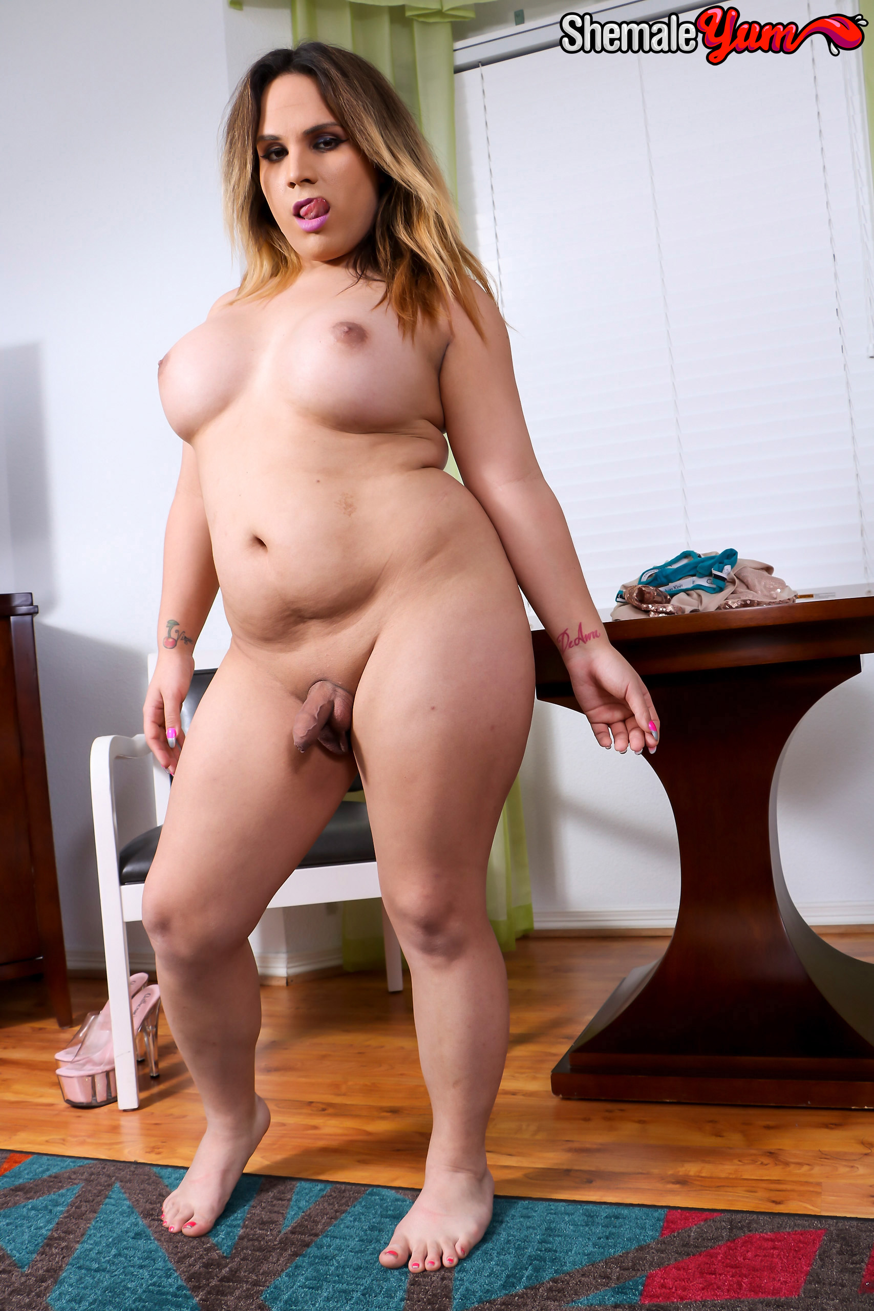 image Gorgeous shemale stripping and gives blowjob